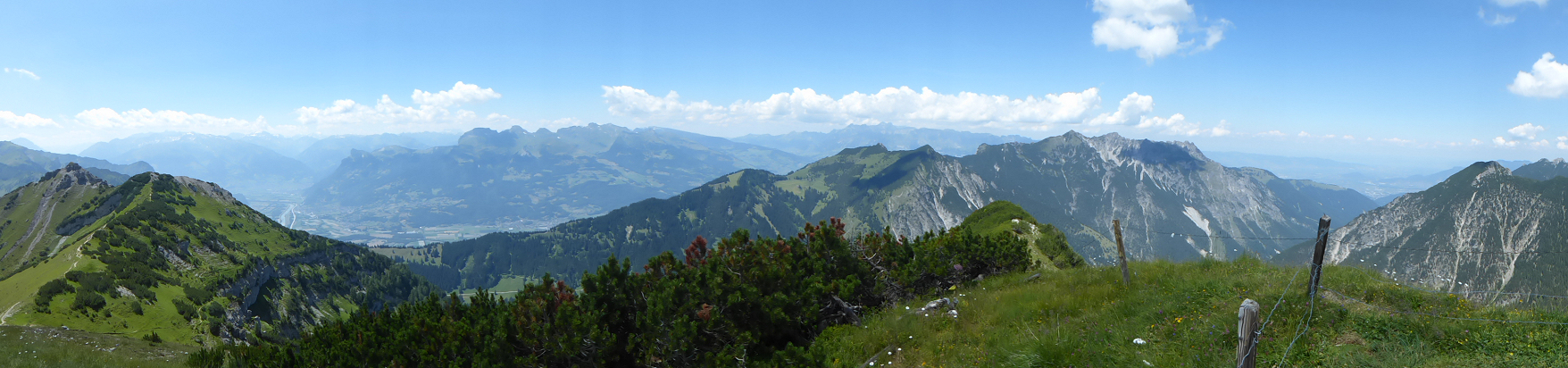 Panorama − View from Schönberg in direction to the Rhine and the mountain range from Helwangspitz to Drei Schwestern